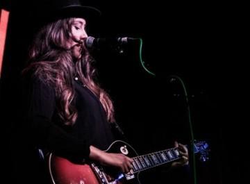 Dakota playing the guitar